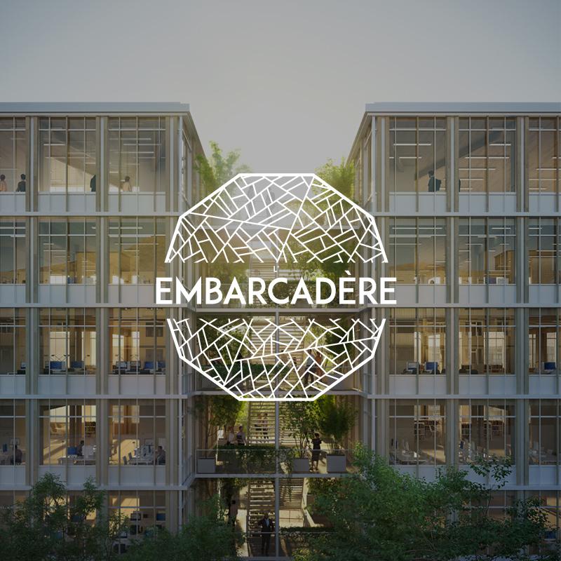 Logo du projet embarcadère sur fond avec des immeubles