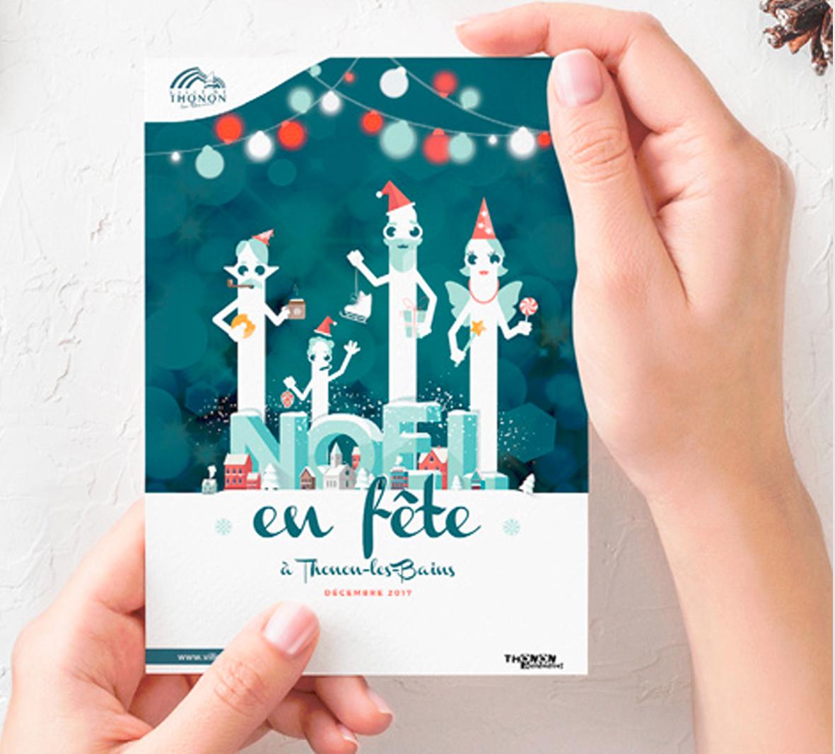 Affiche tenue dans des mains pour la Fête de Noël de la ville de Thonon-Les-Bains