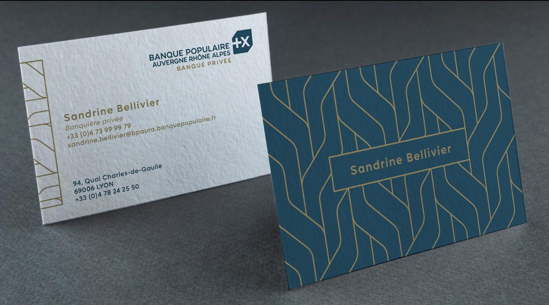 Cartes de visites et papeterie mis aux couleurs de la charte graphique de la Banque